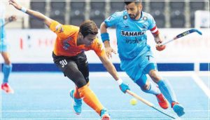 manpreet-singh-vying-for-the-ball-in-an-international-match-with-a-rival-defender