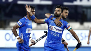 manpreet-singh-taking-team*together-in-celebration-after-goal