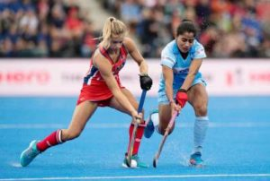 Woman Hockey players in a tussle for ball possession