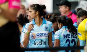 Senior Indian Woman Hockey Player Exulting after Goal