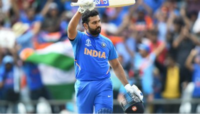 Rohit Sharma raising bat after reaching a milestone