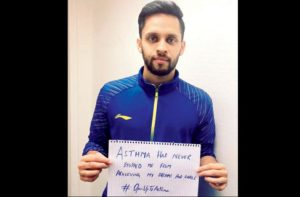 Parupalli Kashyap Campaigning to fight asthma with a placard