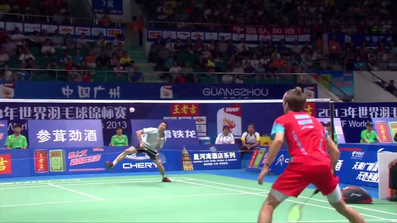 A badminton player returning a smash to the other