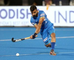 Hockey Captain Manpreet Singh hitting the ball during Play