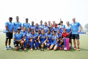 Indian-Junior-women's-hockey-team-posing-with-the-trophy