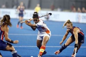 Indian Women's Hockey Captain Rani Rampal in the stance to hit the ball in a match