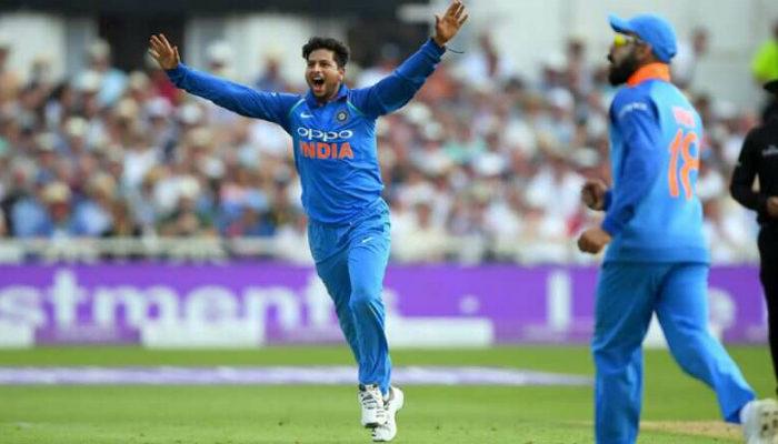 kuldeep-yadav-celebrating-a-wicket-with-hands-raised-as-virat-kohli-runs-to-him