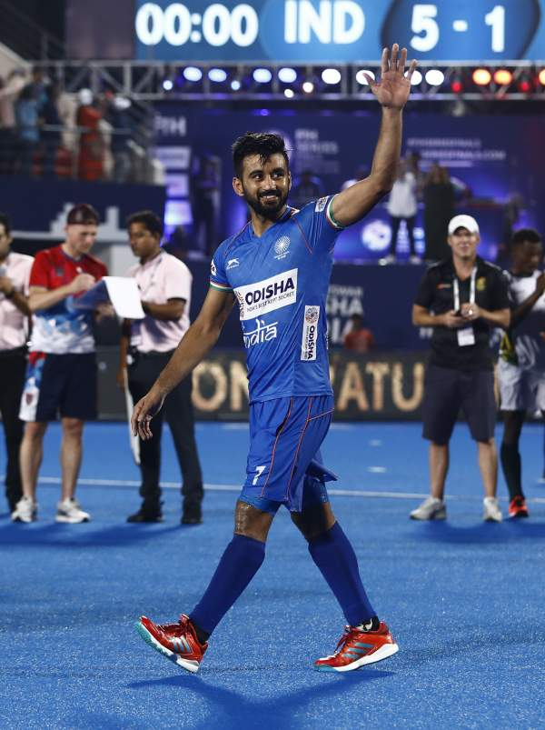 Hockey Captain Manpreet Singh waves to crowd acknowledging its cheers