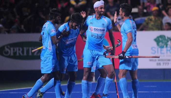 mandeep-singh-celebrating-with-team-mates-after-scoring
