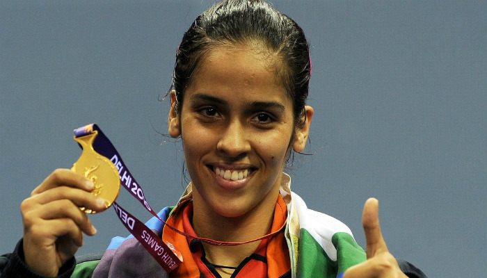 saina-nehwal-showing-gold-medal-with-right-hand-and thumbs-up-with-left-hand