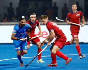 indian-hockey-player-akashdeep-singh-gunning-for-the-ball-with-rival-forwards
