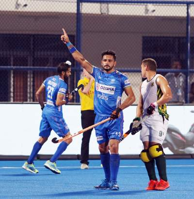 harmanpreet-singh-celebrating-goal-with-hand-raised-and-index-finger-pointing-to-sky-