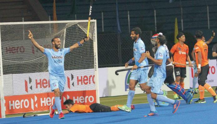 ramandeep-singh-with-teammates-celebrating-a-goal-hands-raised-under-rival-goalpost