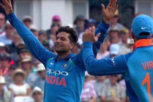Kuldeep-Yadav-celebrating-a-wicket-with-arms-raised