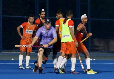 India-hockey-coach-with-players-at-camp