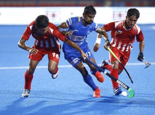 India-Hockey-Player-Sumit-Vying-For-Ball-Possession