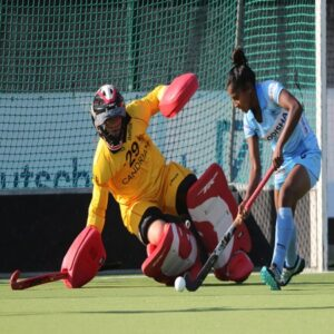 Indian-womens-hockey-striker-Mumtaz-Khan-tries-to-score-past-goalkeeper