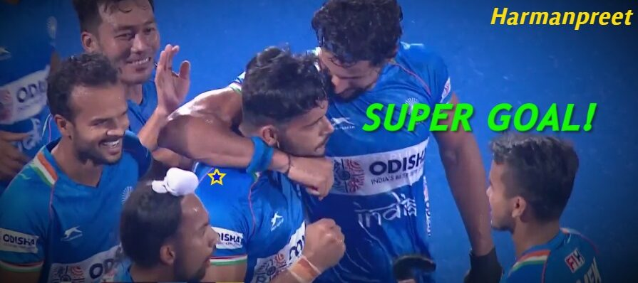 indian-hockey-player-harmanpreet-singh-surrounded-by-teammates-after-scoring-a-goal