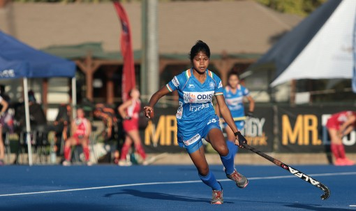 indian-junior-woman-hockey-player-in-action